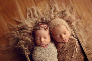 Newborn twins, boy and girl wrapped in browns in a box with textured furs from Felt Fur