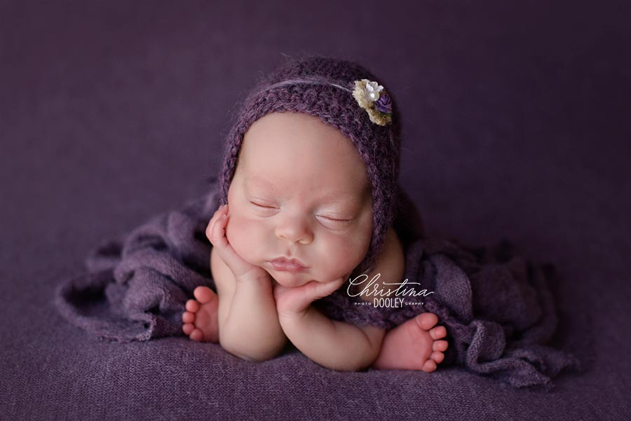 Baby Annabelle photographed on purple in the froggy pose