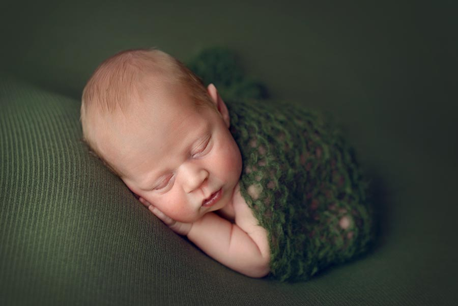 Baby Boy wrapped in Green Knit wrap in taco pose