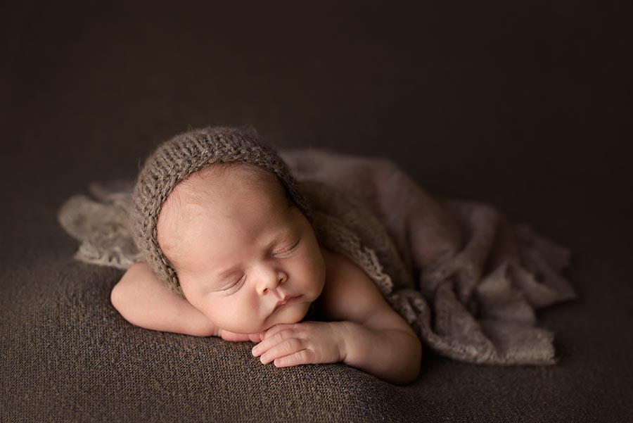 Newborn Baby boy photo session using chocolate brown colors and a bonnet from Wild Blossom Photo Props