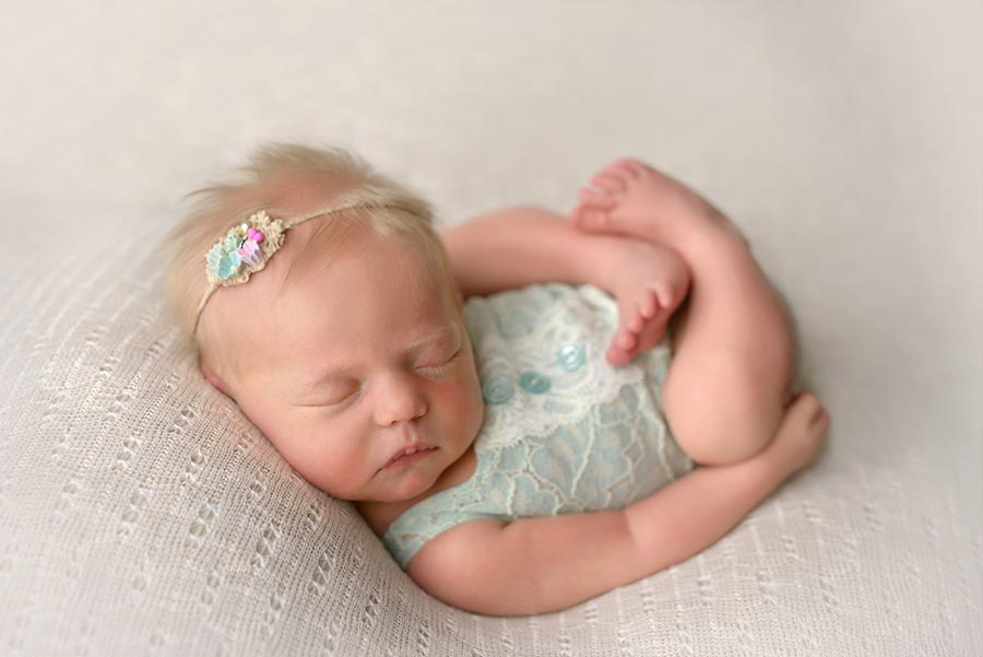 7 day old newborn photos dressed in mint green on white