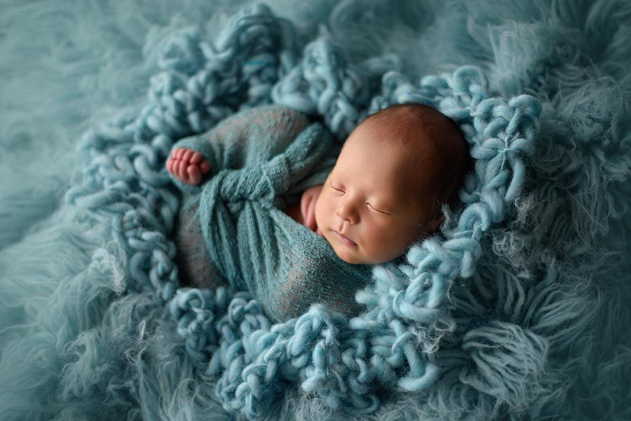 Baby boy photo in a cloud of fluffy blue