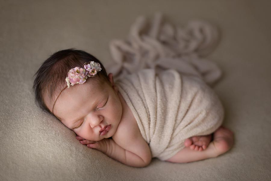 Baby girl newborn photo session, photographed in neutrals on a background and wrap from AR Backdrops