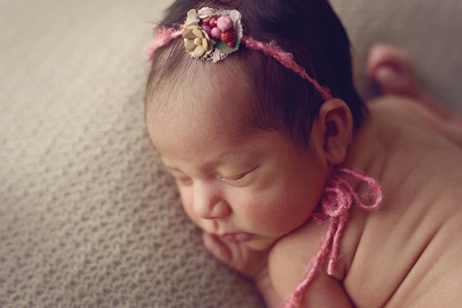 Close up portrait of newborn girl.