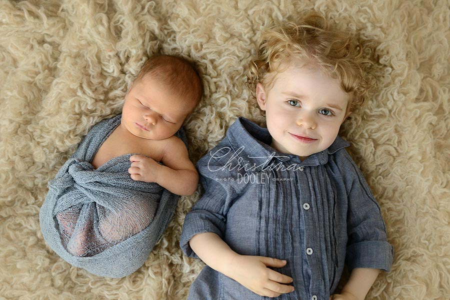 Newborn baby boy with his new big brother