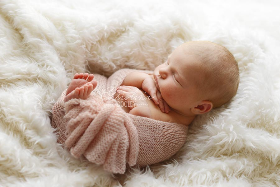 Baby Girls swaddled in knit pink wrap from Goodnight Mouse Newborn Props