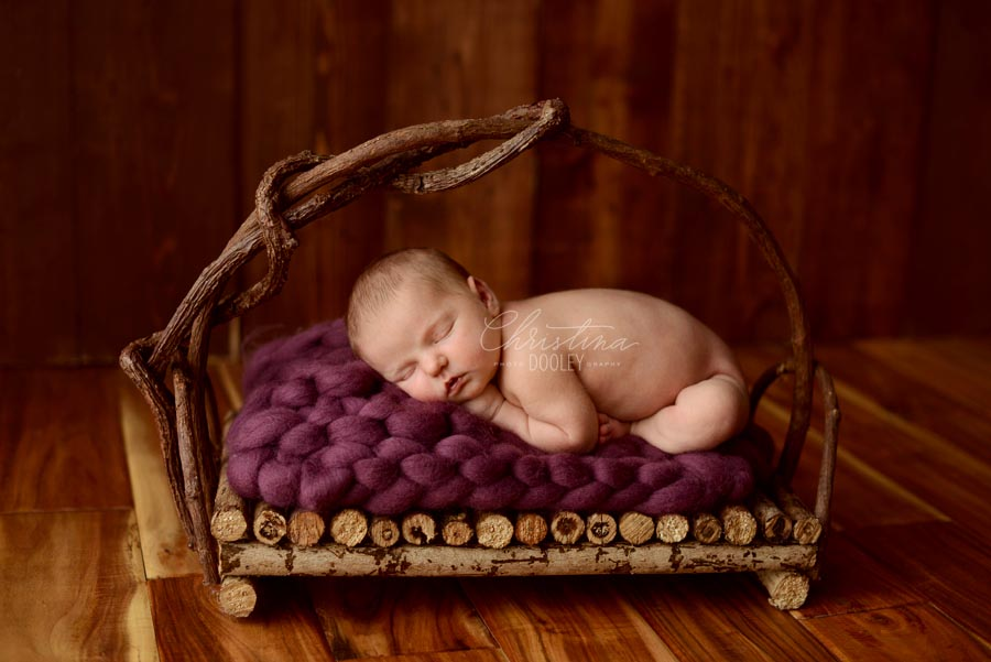 Newborn girls on purple posed on a wood basket from JD Vintage Props