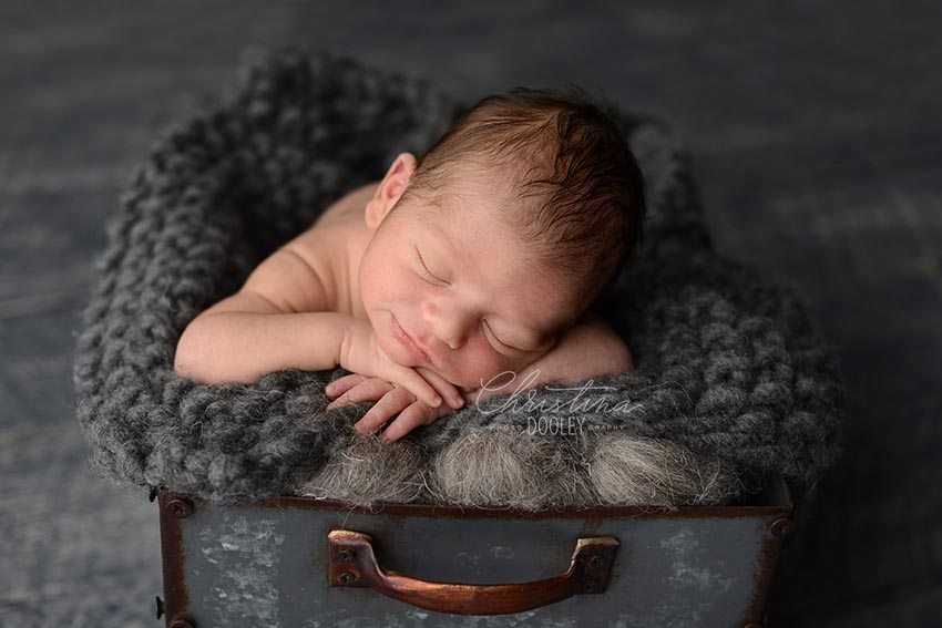 Baby boy posed and photographed in a metal box from JD Vintage Props