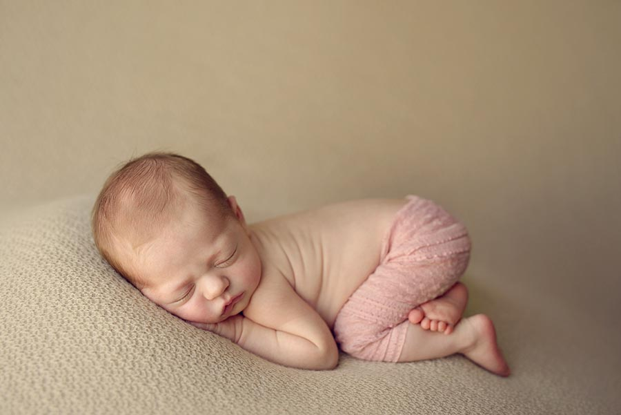 Baby girl wearing pink lace pants from Adorable Props for her newborn photo session in Denver, Colorado.
