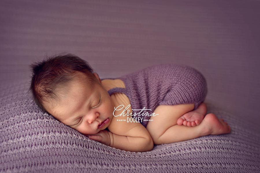 Baby girl in tussle up pose on purple