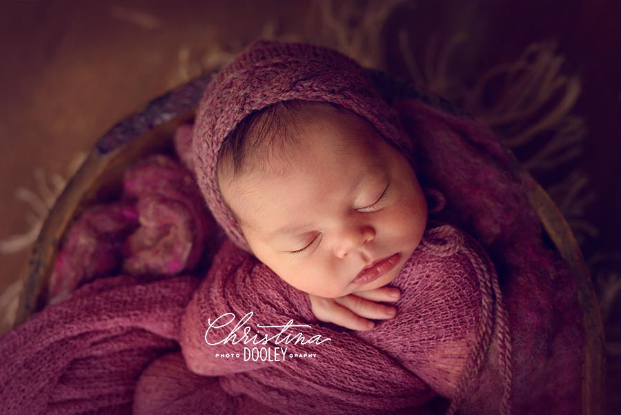 Baby wrapped and posed in a vintage bowl