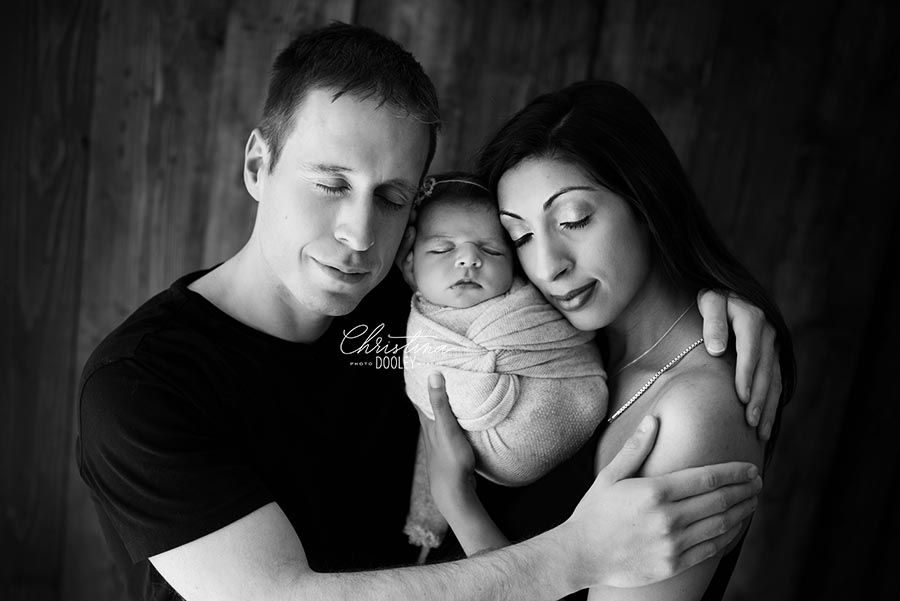 Black and White newborn family image photographed in a Denver, Colorado photography studio
