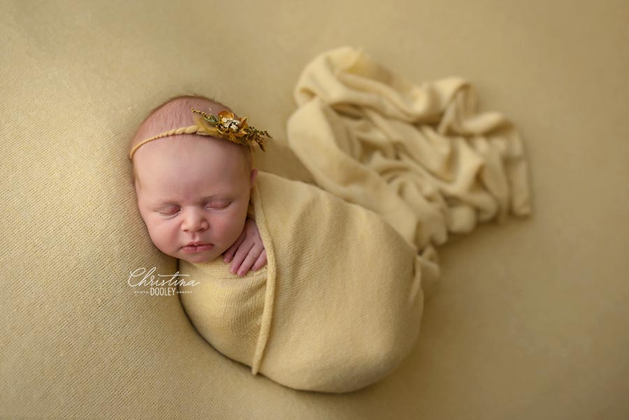 Red Headed newborn photographed wrapped in yellow in Denver, Colorado