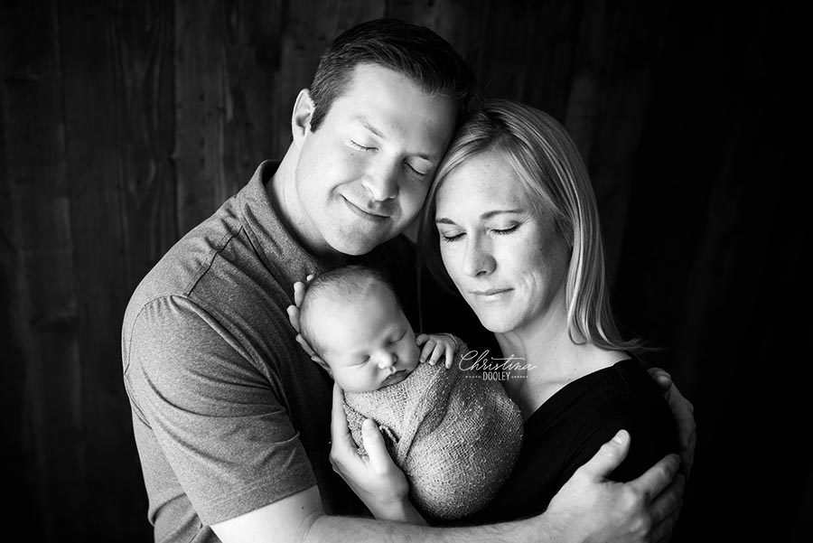 First family photo with their new baby boy in black and white in Denver Colorado