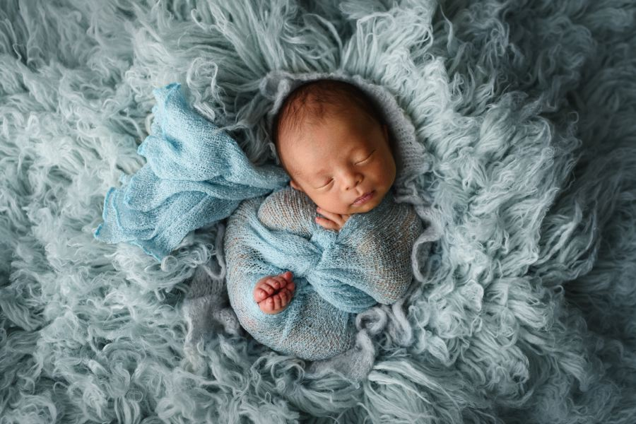 Best Newborn Photography of Denver little baby photographed on blue fur