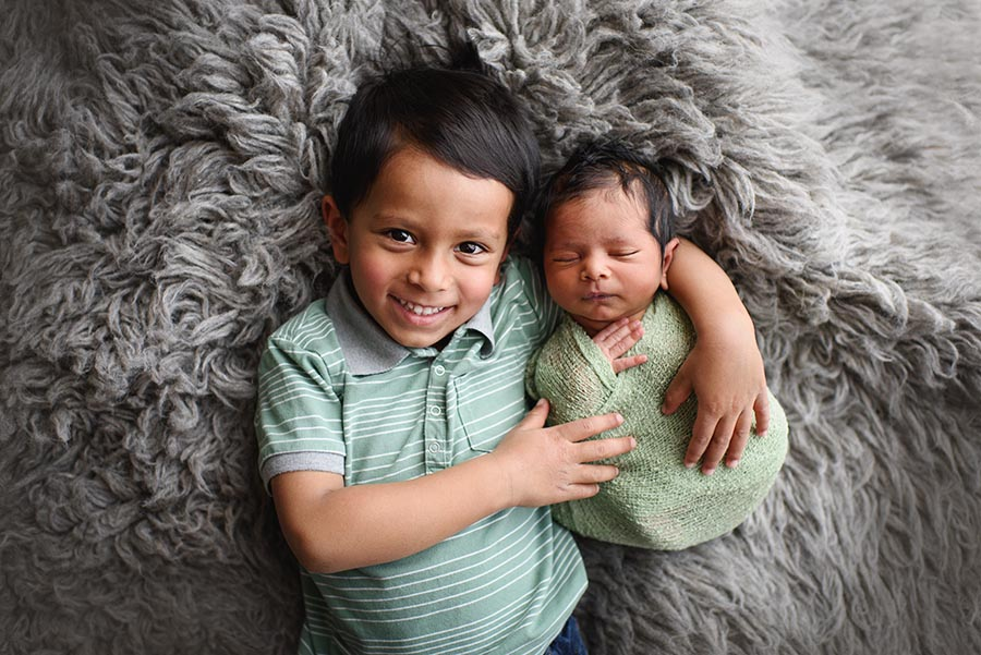 First Portrait of two brothers on gray at just 10 days old in Denver, Colorado