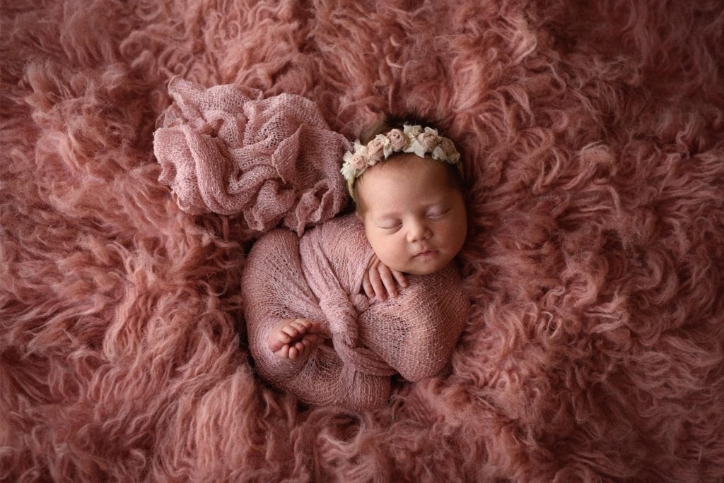 Baby girl all snuggled up in pink